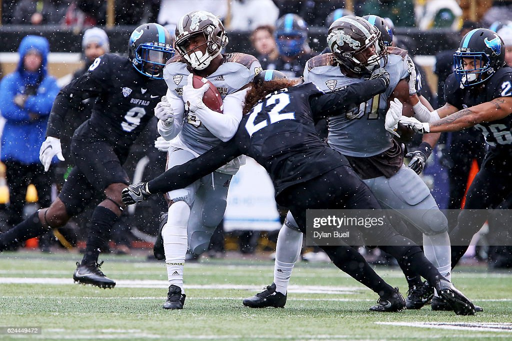 Tim Roberts #22 of the Buffalo Bulls hits Michael Henry #83 of the Western Michigan Broncos in the first quarter at Waldo Stadium on November 19, 2016 in Kalamazoo, Michigan.