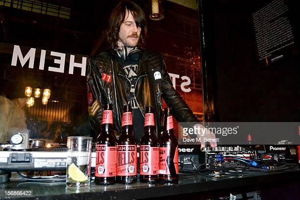 DJ Tim Rockins attends the launch of the Stutterheim Raincoats pop up shop in Shoreditch on November 22 2012 in London England