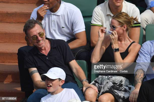 Tim Roth and his wife Nikki Butler attend the Men Final of the 2018 French Open Day Fithteen at Roland Garros on June 10 2018 in Paris France