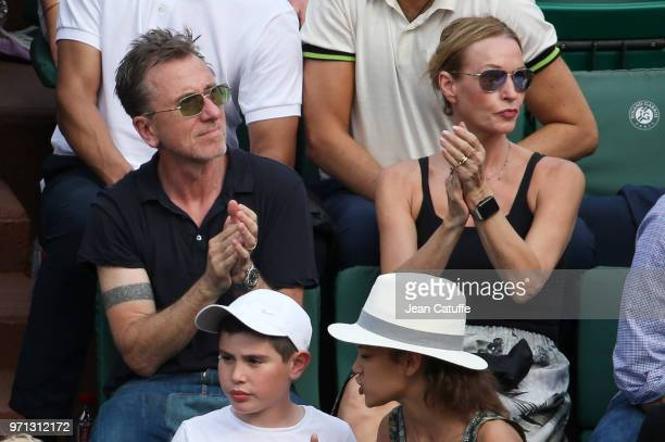 Tim Roth and his wife Nikki Butler during the men's final on Day 15 of the 2018 French Open at Roland Garros stadium on June 10 2018 in Paris France