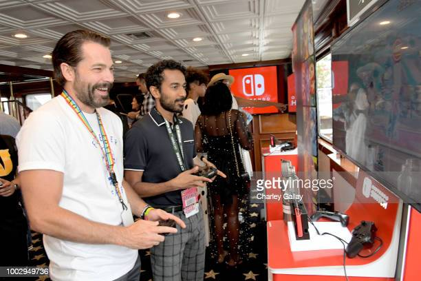 Tim Rozon and Varun Saranga test their skills on Super Smash Bros Ultimate for Nintendo Switch at the Variety Studio at ComicCon 2018 on July 20 2018...