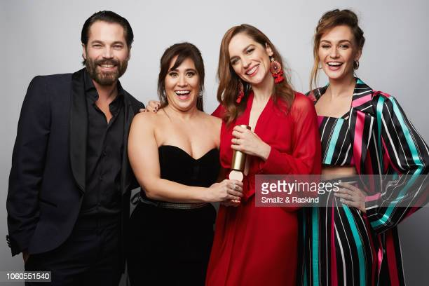 Tim Rozon Emily Andras Melanie Scrofano and Katherine Barrell of Wynonna Earp pose for a portrait during the 2018 People's Choice Awards at The...