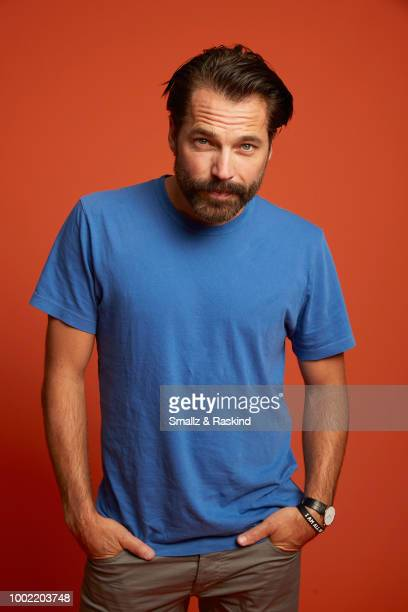 Tim Rozon from Syfy's 'Wynonna Earp' poses for a portrait in the Getty Images Portrait Studio powered by Pizza Hut at San Diego 2018 Comic Con at...