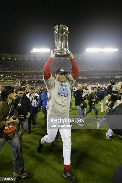 Tim Salmon of the Anaheim Angels lifts the World Series trophy during the celebration after winning game seven of the World Series against the San...