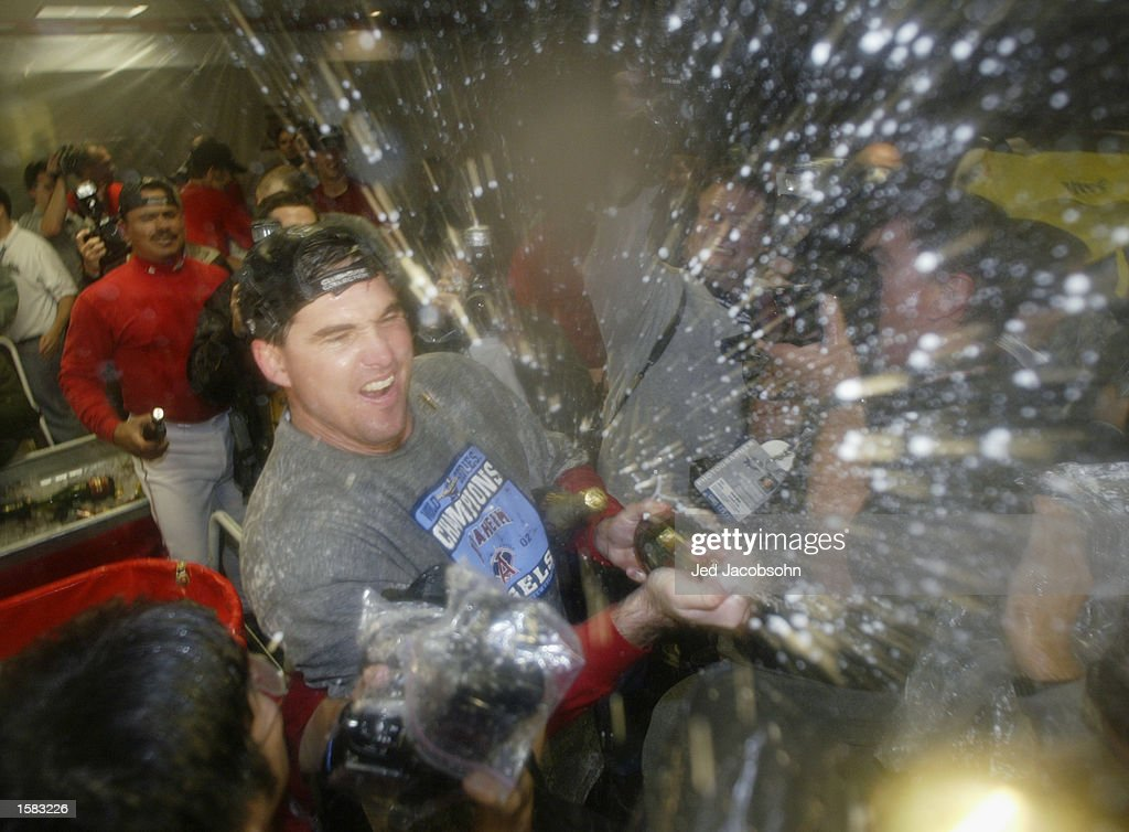 Tim Salmon sprays teammates with champagne after winning the World Series  : News Photo