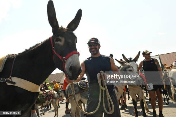 Tim Scaturro of Lakewood stands at the start line with his donkey Charlie before taking part in the 70th annual World Championship Pack Burro Race on...