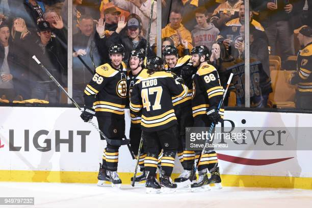 Tim Schaller Noel Acciari Torey Krug Sean Kurlay and Kevan Miller of the Boston Bruins celebrate the goal against the Toronto Maple Leafs in Game...