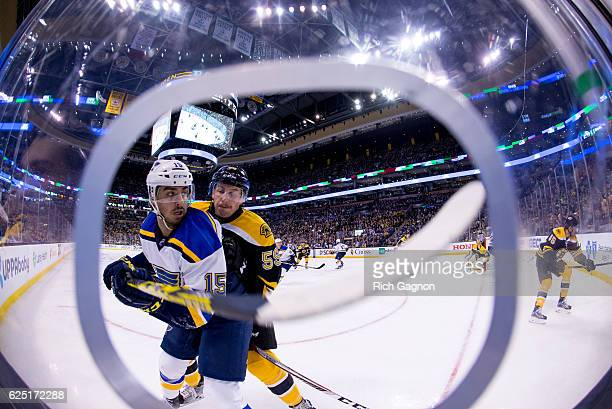 Tim Schaller of the Boston Bruins checks Robby Fabbri of the St Louis Blues during the second period at TD Garden on November 22 2016 in Boston...