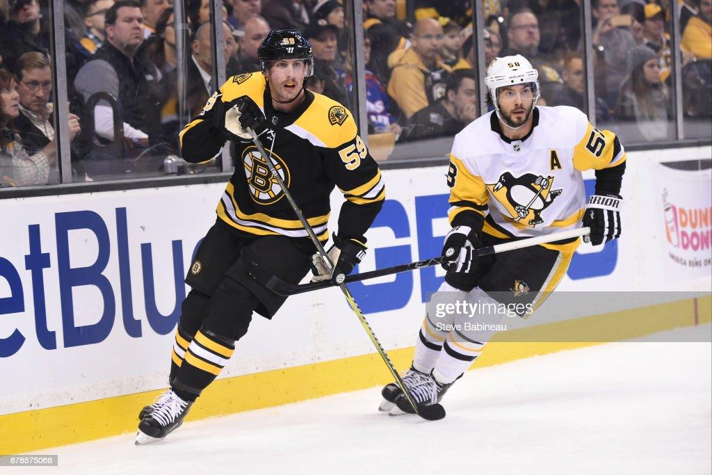 Tim Schaller #59 of the Boston Bruins skates against Kris Letang #58 of the Pittsburgh Penguins at the TD Garden on November 24, 2017 in Boston, Massachusetts.