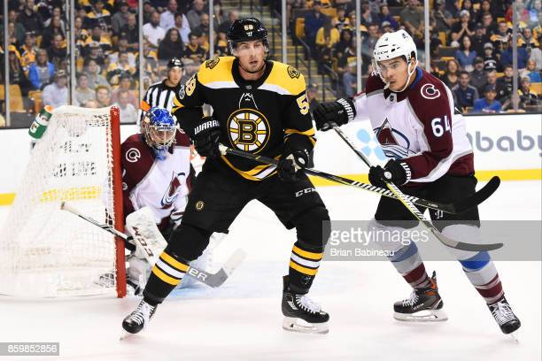 Tim Schaller of the Boston Bruins watches the play against Semyon Varlamov and Nail Yakupov of the Colorado Avalanche at the TD Garden on October 9...