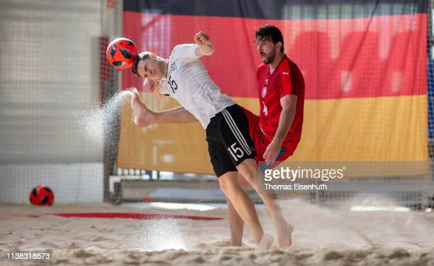 Tim Schmitt of Germany is challenged by Martin Bocek of the Czech Republic during the Beach Soccer International Friendly match between Germany and...
