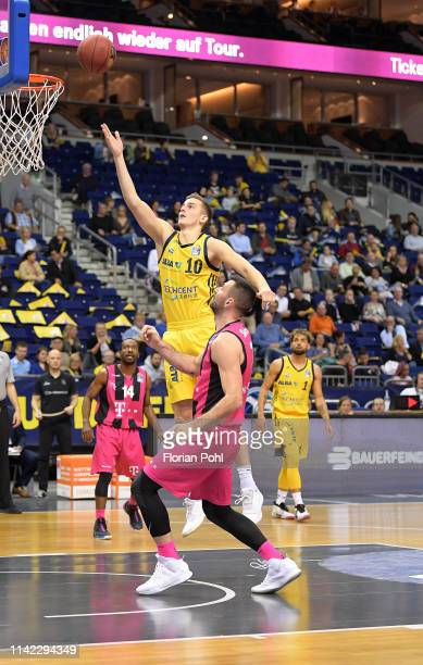 Tim Schneider of Alba Berlin and Bojan Subotic of Telekom Baskets Bonn during the BBL match between Alba Berlin and dem Telekom Baskets Bonn on May 8...