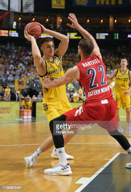 Tim Schneider of Alba Berlin and Danilo Barthel during the BBL final match between Alba Berlin and the FC Bayern Muenchen on June 19 2019 at the...