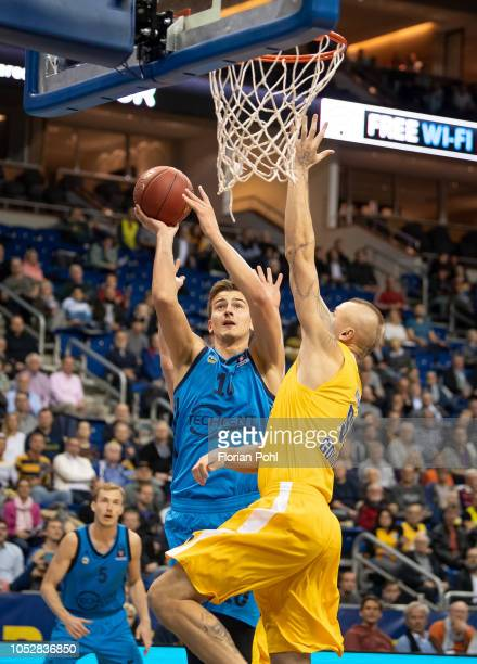 Tim Schneider of Alba Berlin and Dariusz Wyka of Arka Gdynia during the Eurocup match between Alba Berlin and Arka Gdynia at MercedesBenz Arena on...
