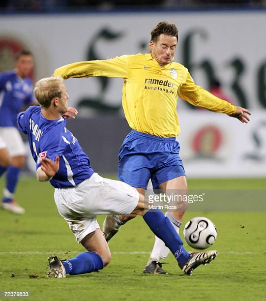 Tim Sebastian of Rostock and Ronald Maul of Jena fight for the ball during the Second Bundesliga match between Hansa Rostock and Carl Zeiss Jena at...