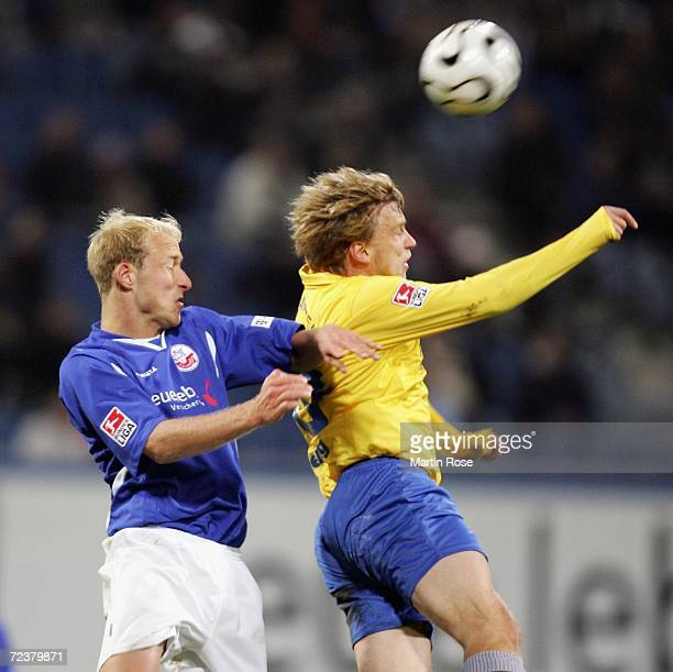 Tim Sebastian of Rostock and Sebastian Helbig of Jena compete in the air for the ball during the Second Bundesliga match between Hansa Rostock and...