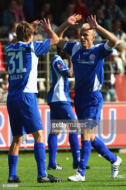 Tim Sebastian of Rostock celebrates scoring his team's second goal with team mate Kai Buelow during the Second Bundesliga match between RotWeiss...