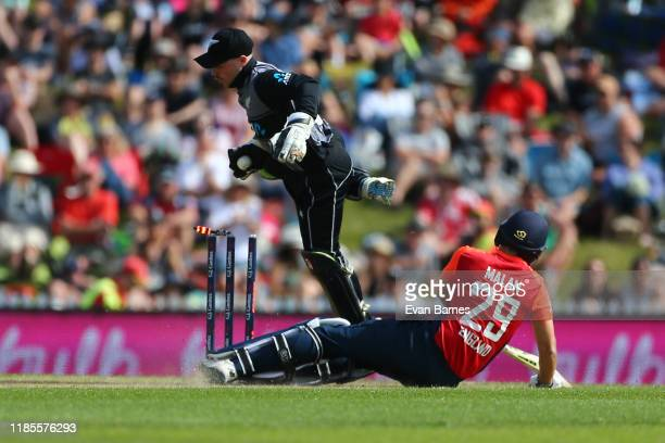 Tim Seifert of New Zealand attempts a run out of Dawid Malan during game three of the Twenty20 International series between New Zealand and England...