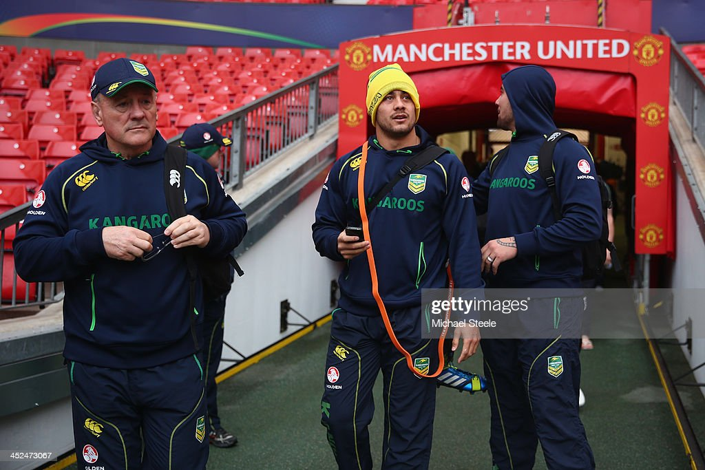 Tim Sheens (L), head coach of Australia walks from the players tunnel alongside Jarryd Hayne (C) and Andrew Fifita (R) during the Australia training session at Old Trafford on November 29, 2013 in Manchester, England.