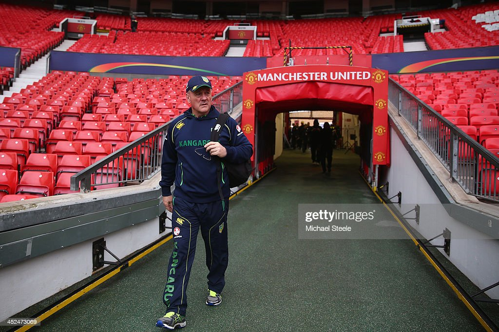 Tim Sheens, head coach of Australia walks out from the players tunnel during the Australia training session at Old Trafford on November 29, 2013 in Manchester, England.