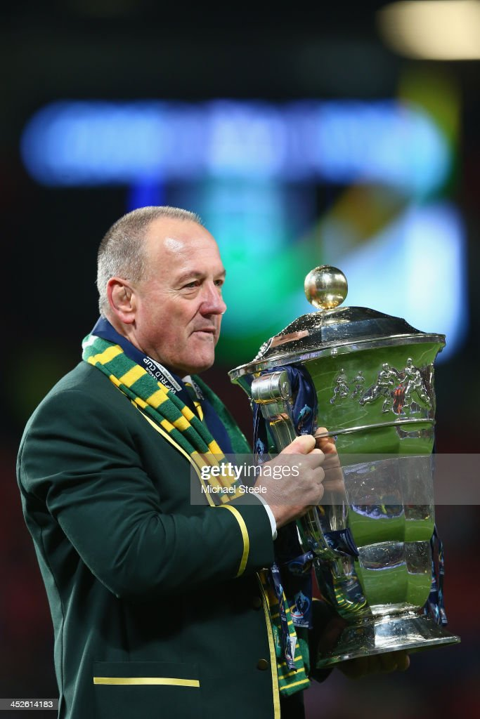 Tim Sheens the head coach of Australia with the winners trophy after his sides 34-2 victory during the Rugby League World Cup Final between Australia and New Zealand at Old Trafford on November 30, 2013 in Manchester, England.