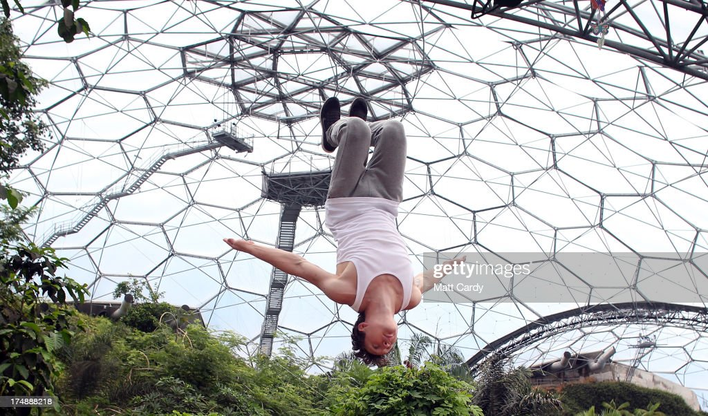 Tim Sheiff, professional freerunner and parkour expert somersaults inside the Eden Project's Rainforest Biome on July 29, 2013 in St Austell, England. Pip Andersen and Tim Shieff who are both members of the pro freerunning team Storm Freerun, were at the Eden Project to help make a promotional video for the Cornish attraction. Following one of the driest July on record, visitor numbers to the region are reported to be higher than previous years and many attractions and resorts are hoping for a busy summer season.