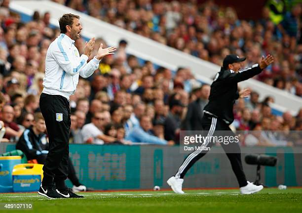 Tim Sherwood Manager of Aston Villa and Tony Pulis manager of West Bromwich Albion gesture during the Barclays Premier League match between Aston...