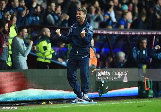 Tim Sherwood manager of Aston Villa celebrates as Christian Benteke of Aston Villa scores their second goal during the Barclays Premier League match...