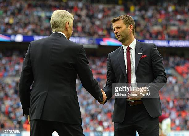 Tim Sherwood manager of Aston Villa shakes hands with Arsene Wenger manager of Arsenal after the FA Cup Final between Aston Villa and Arsenal at...