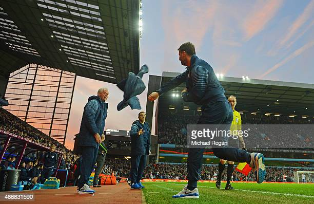 Tim Sherwood manager of Aston Villa throws his jacket in celebration as Christian Benteke of Aston Villa scores their first and equalising goal...