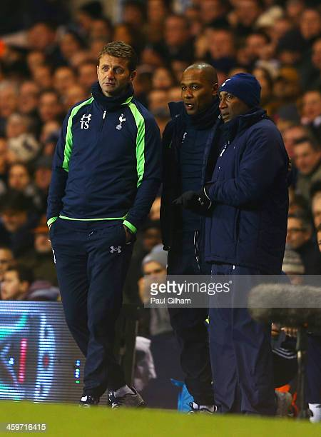 Tim Sherwood, manager of Tottenham Hotspur looks on with forwards coach Les Ferdinand during the Barclays Premier League match between Tottenham...