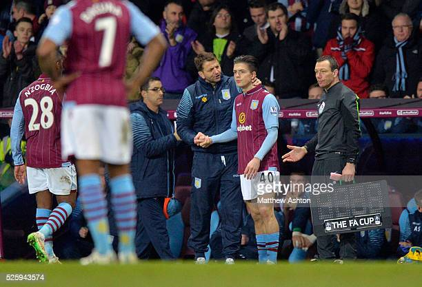 Tim Sherwood the manager / head coach of Aston Villa speaks to Jack Grealish of Aston Villa as he prepares to come on as a substitute