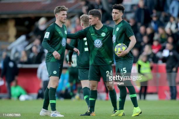 Tim Siersleben of VfL Wolfsburg U19, Luis Manuel Saul of VfL Wolfsburg U19 and Michael Edwards of VfL Wolfsburg U19 looks dejected after the...