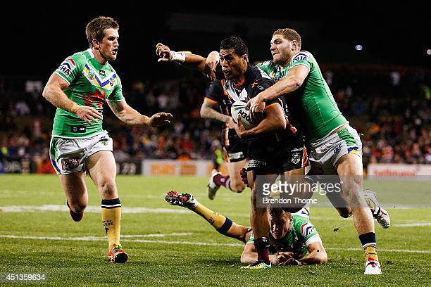 Tim Simona of the Tigers breaks the Raiders defence during the round 16 NRL match between the Wests Tigers and the Canberra Raiders at Campbelltown...