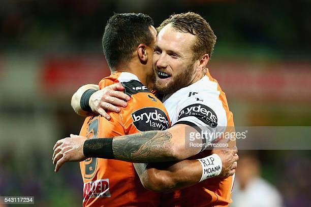 Tim Simona of the Tigers celebrates with a teammate after scoring a try during the round 16 NRL match between the Melbourne Storm and Wests Tigers at...