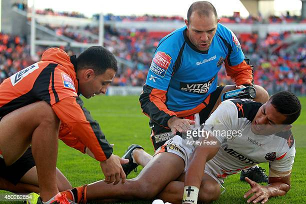 Tim Simona of the Tigers injured during the round 13 NRL match between the Newcastle Knights and the Wests Tigers at Hunter Stadium on June 8 2014 in...