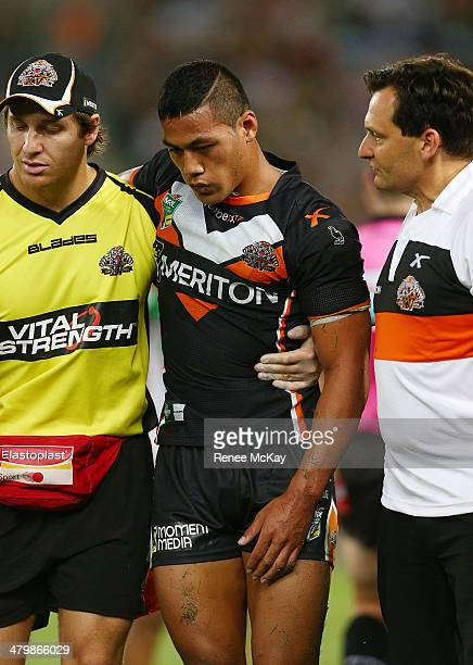 Tim Simona of the Tigers leaves the field with concussion during the round three NRL match between the Wests Tigers and the South Sydney Rabbitohs at...
