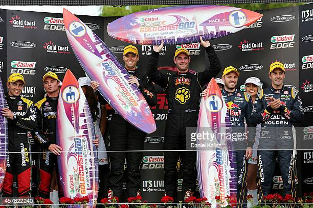 Tim Slade and Tony D'Alberto drivers of the Supercheap Auto Racing Holden Shane van Gisbergen and Jonathon Webb drivers of the TEKNO VIP Petfoods...
