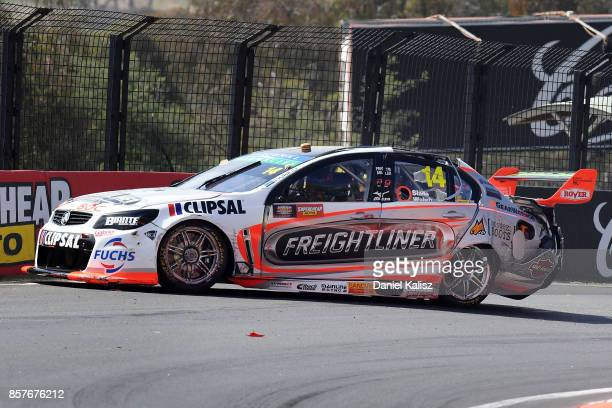 Tim Slade driver of the Freightliner Racing Holden Commodore VF crashes during practice ahead of this weekend's Bathurst 1000 which is part of the...