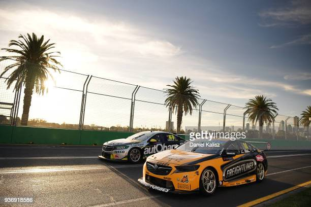 Tim Slade driver of the Freightliner Racing Holden Commodore ZB passes Craig Lowndes drives the Autobarn Lowndes Racing Holden Commodore ZB during...