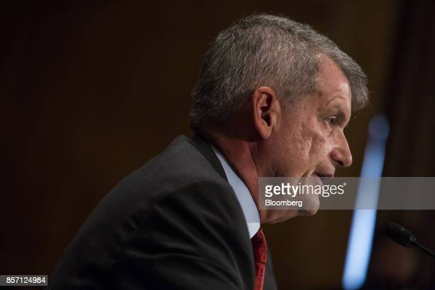 Tim Sloan chief executive officer and president of Wells Fargo Co speaks during a Senate Banking Housing and Urban Affairs Committee hearing in...