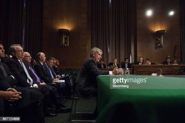 Tim Sloan chief executive officer and president of Wells Fargo Co center speaks during a Senate Banking Housing and Urban Affairs Committee hearing...