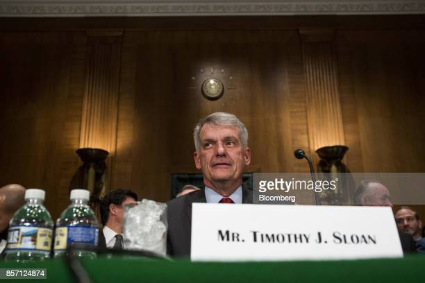 Tim Sloan chief executive officer and president of Wells Fargo Co arrives to testify before a Senate Banking Housing and Urban Affairs Committee...