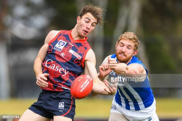 Tim Smith of the Casey Demons reaches for the ball during the VFL round 14 game between the Casey Demons and North Melbourne at Casey Fields in...