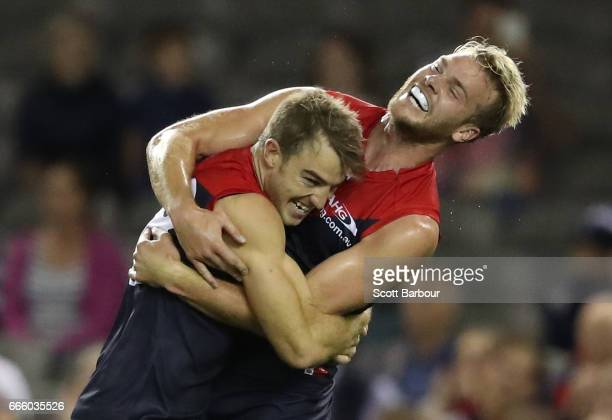 Tim Smith of the Demons celebrates with Jack Watts of the Demons after kicking his first goal in the AFL during the round three AFL match between the...