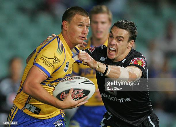 Tim Smith of the Eels is grabbed by Michael Witt of the Warriors during the round 11 NRL match between the Parramatta Eels and the Warriors at...