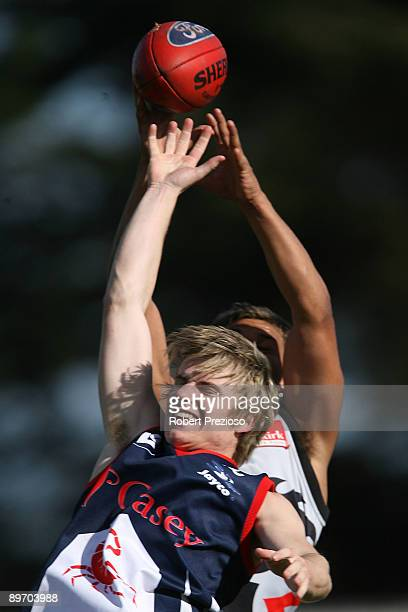 Tim Smith of the Scorpions attempts to mark during the round 17 VFL match between the Casey Scorpions and North Ballarat Roosters at Casey Fields on...
