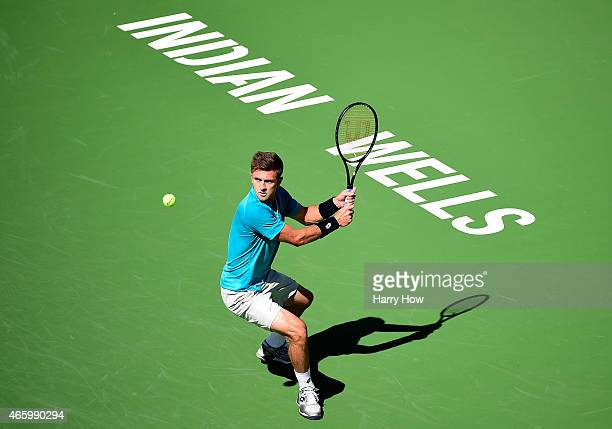Tim Smyczek hits a backhand in his match against Benjamin Becker of Germany during the BNP Parisbas Open at the Indian Wells Tennis Garden on March...