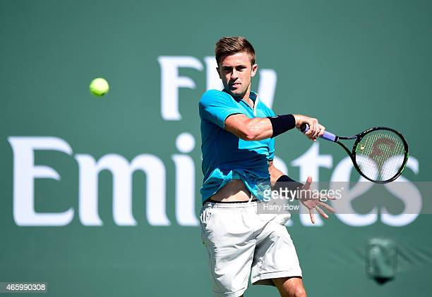 Tim Smyczek hits a forehand in his match against Benjamin Becker of Germany during the BNP Parisbas Open at the Indian Wells Tennis Garden on March...