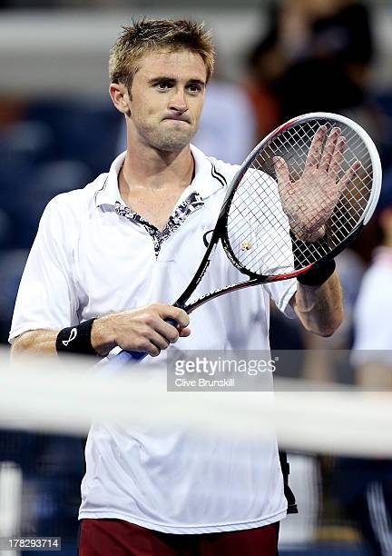 Tim Smyczek of the United States applauds the crowd after his victory against James Duckworth of Australia in their men's singles first round match...